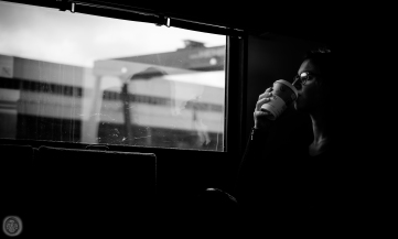 ...girl drinking coffee as Tschernobyl passes by...